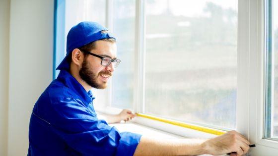 Windows installer wear blue uniform and measure window.