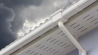White vinyl gutter and downspout.