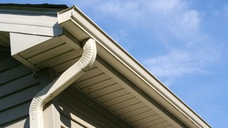 Seamless aluminum gutter and downspout.