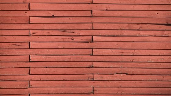 Buckle red wood siding.