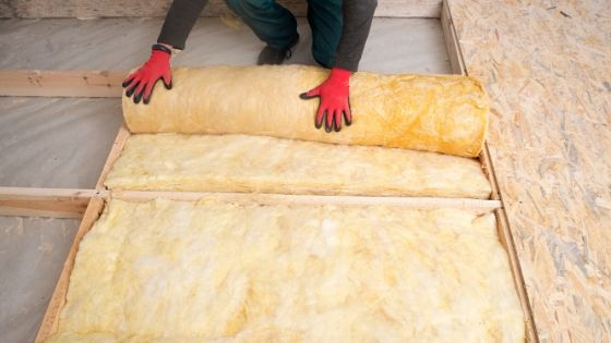 Worker install new roll insulation