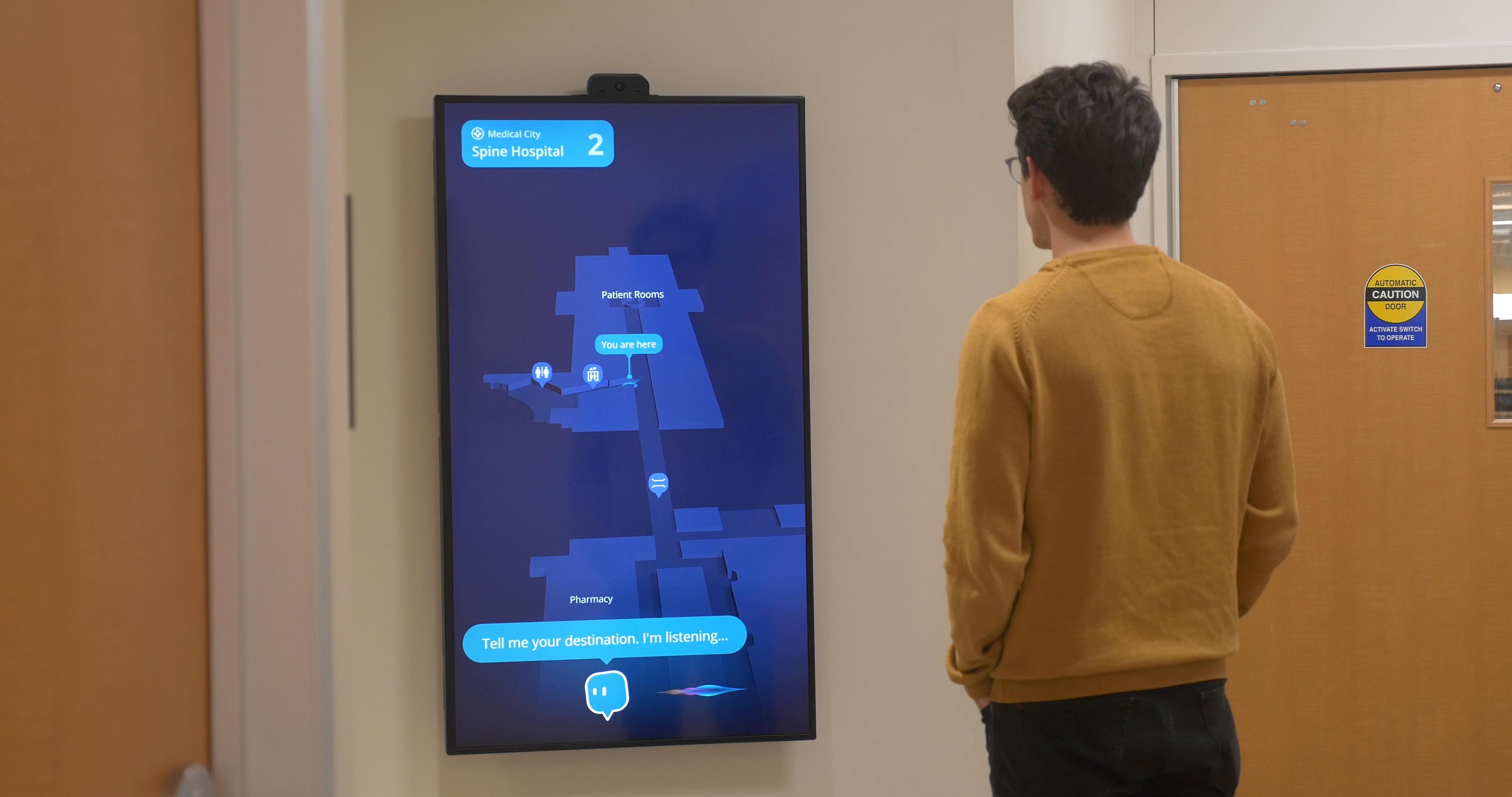 A person looking at a screen showing a virtual assistant and a map