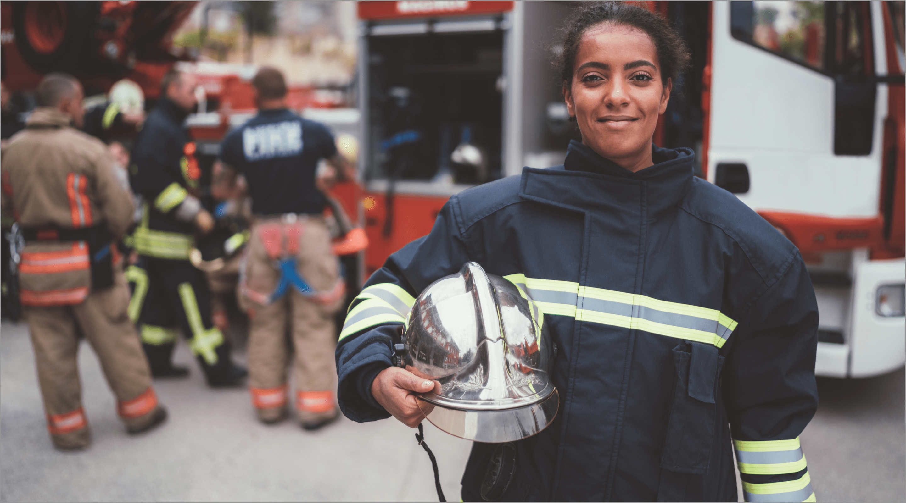 firefighter smiling into the camera