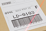 Laser scanning barcode on a parcel's label