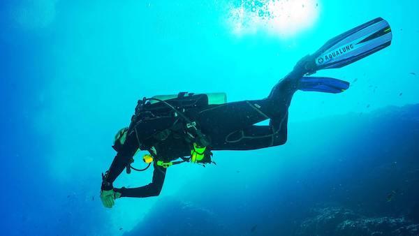 Scuba diver off the coast of Diani Beach in Kenya
