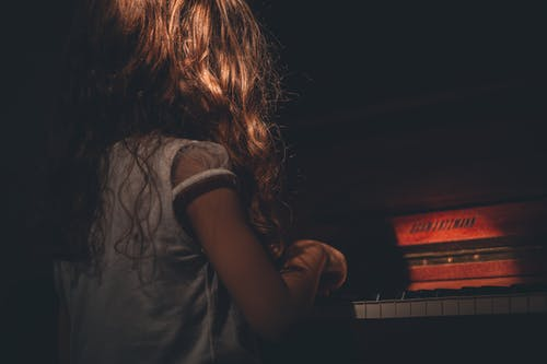 Photo of Girl Playing Piano