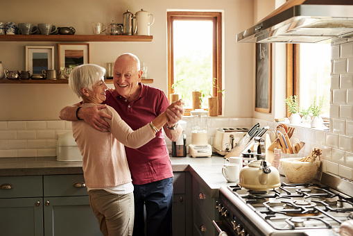 old couple dancing in kitchen