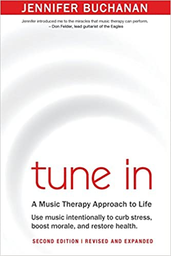A white book cover with a red title of Tune In.