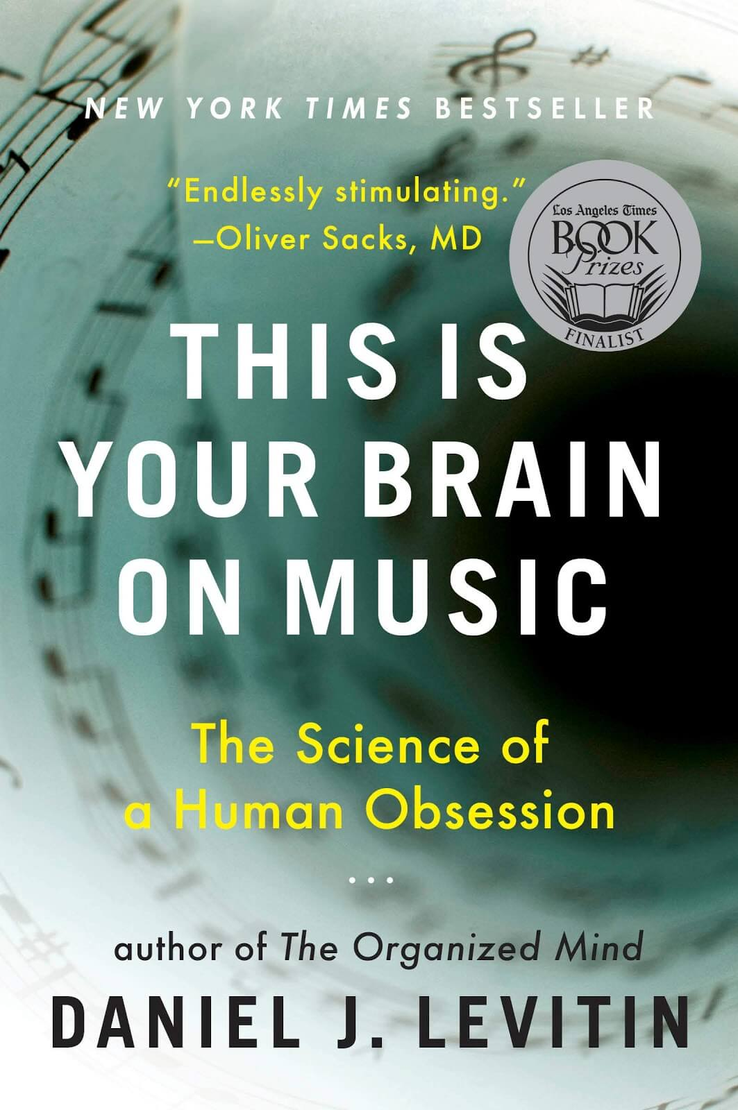 Green book cover of This is Your Brain on Music with music notes