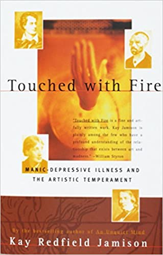 Red and orange book cover of Touched with Fire