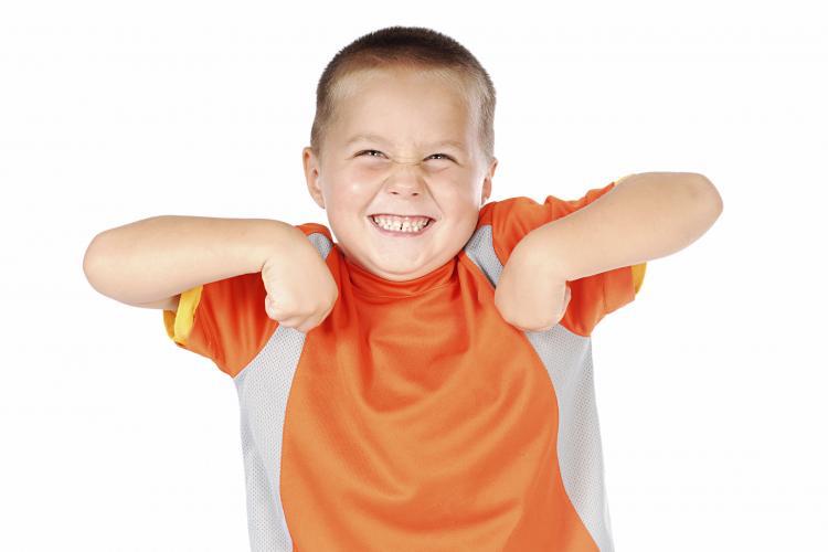 little boy dancing like a chicken.