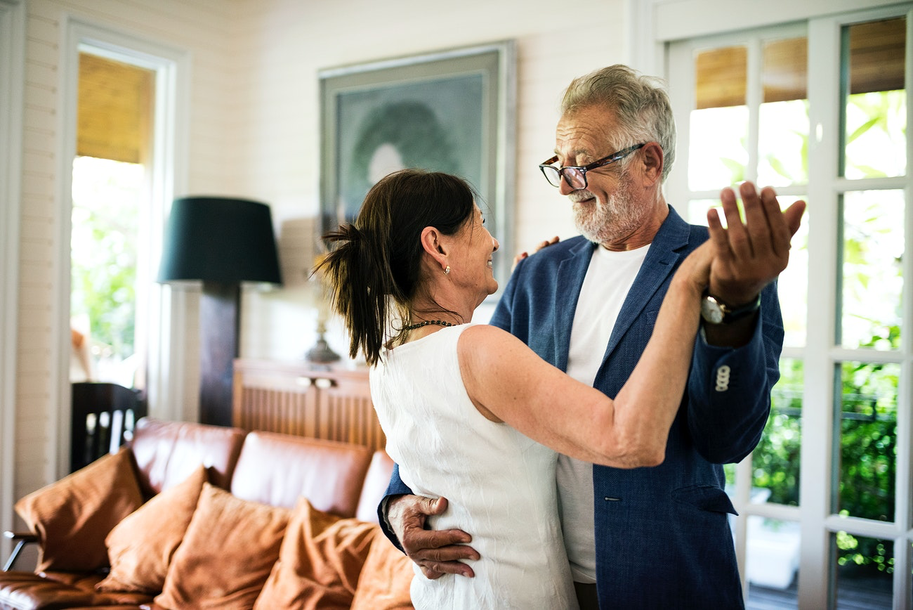 old couple dancing in living room