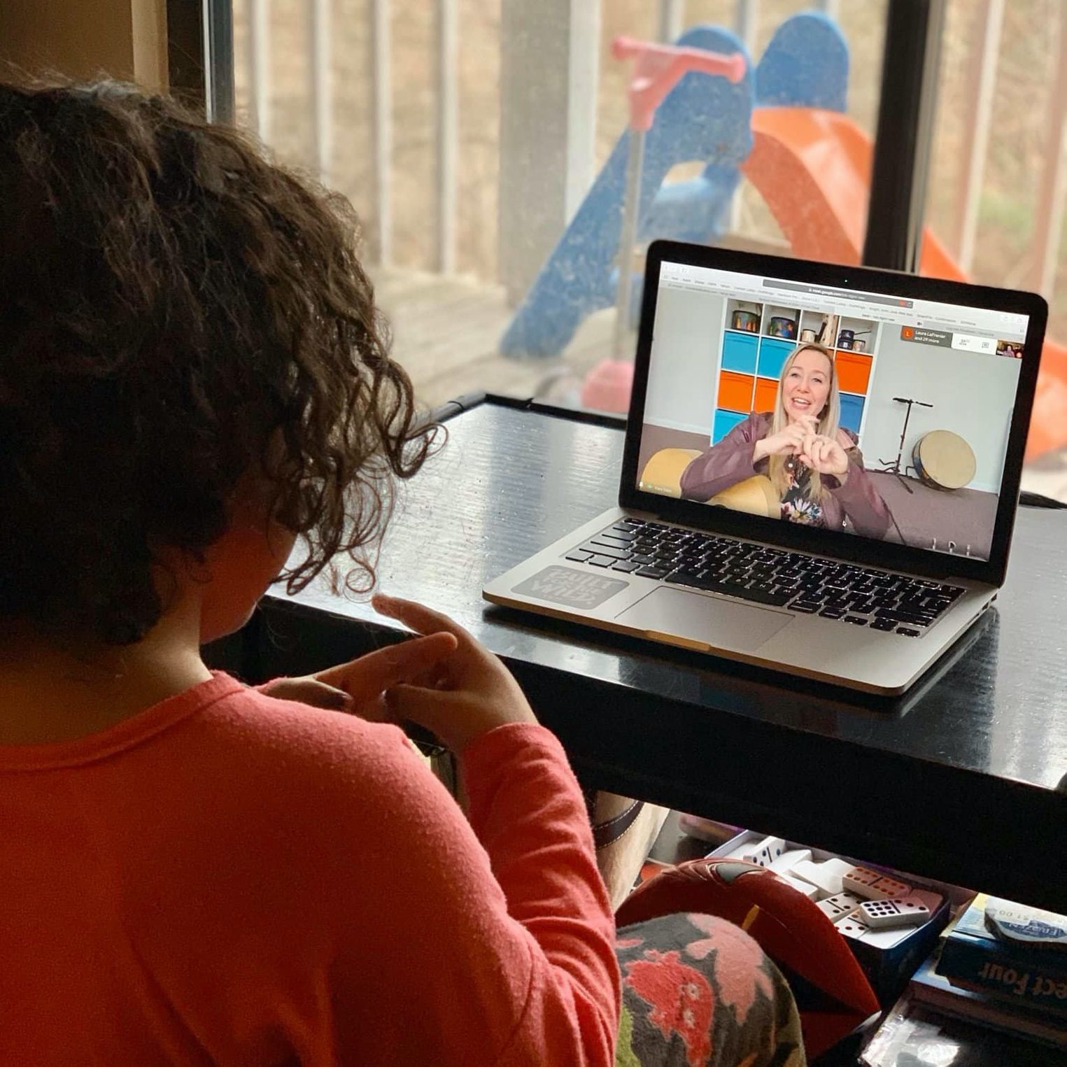 young girl on FaceTime with music therapist