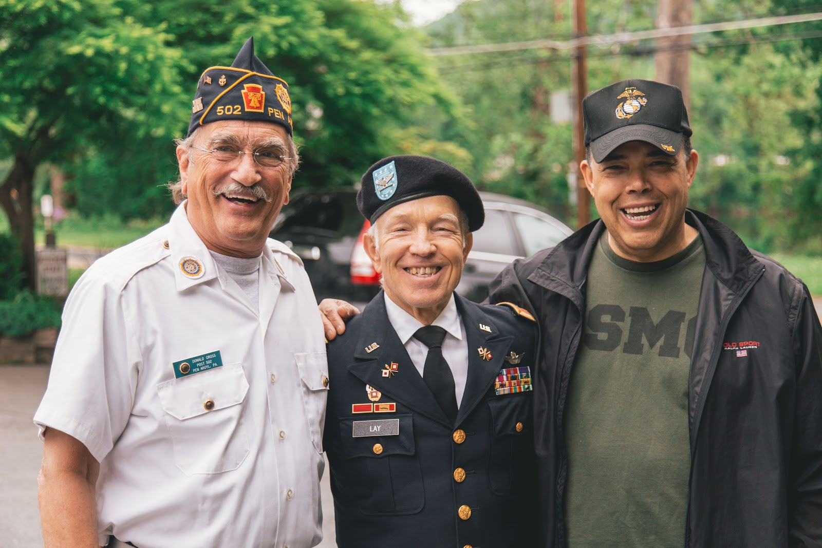 Three smiling veterans
