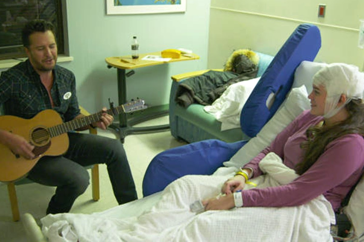Celebrity Luke Bryan playing music for patient