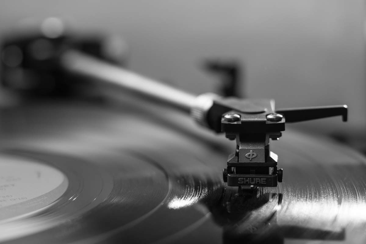 black and white close up image of the needle of a record player