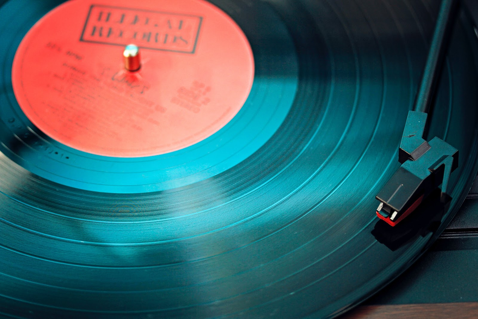 A record being played on a record player.
