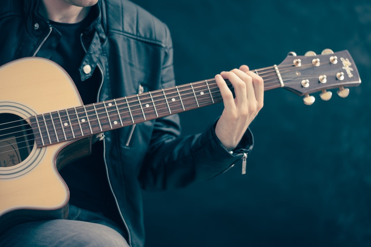 a man plays a guitar