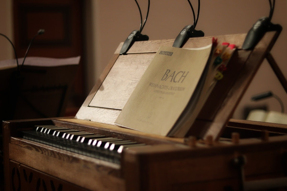 a book of sheet music on an antique piano