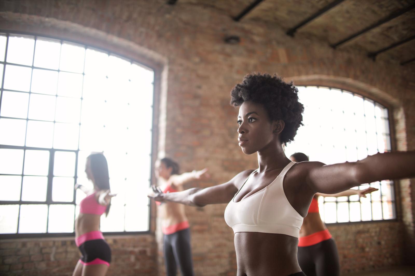 An aerobics class using music to enhance their performance.