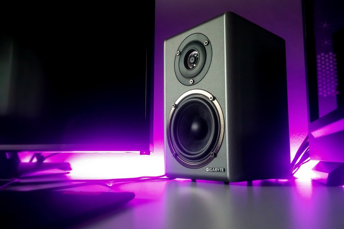 a speaker surrounded by neon purple lighting