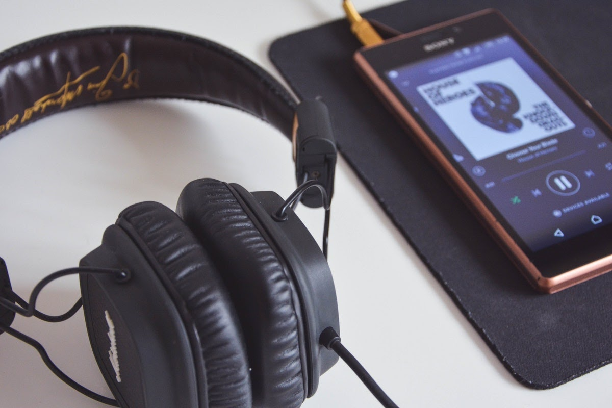 a pair of headphones plugged into a phone