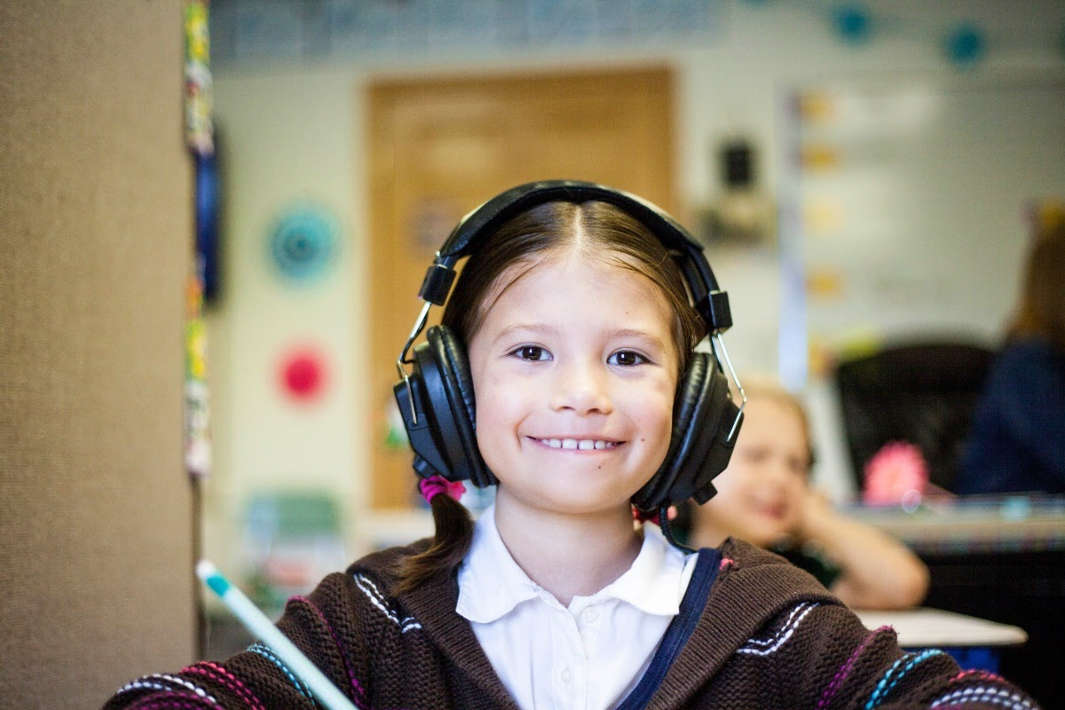 child listening to music and smiling