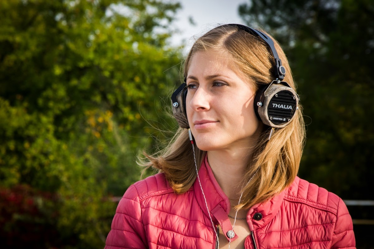 adult listening to music through headphones