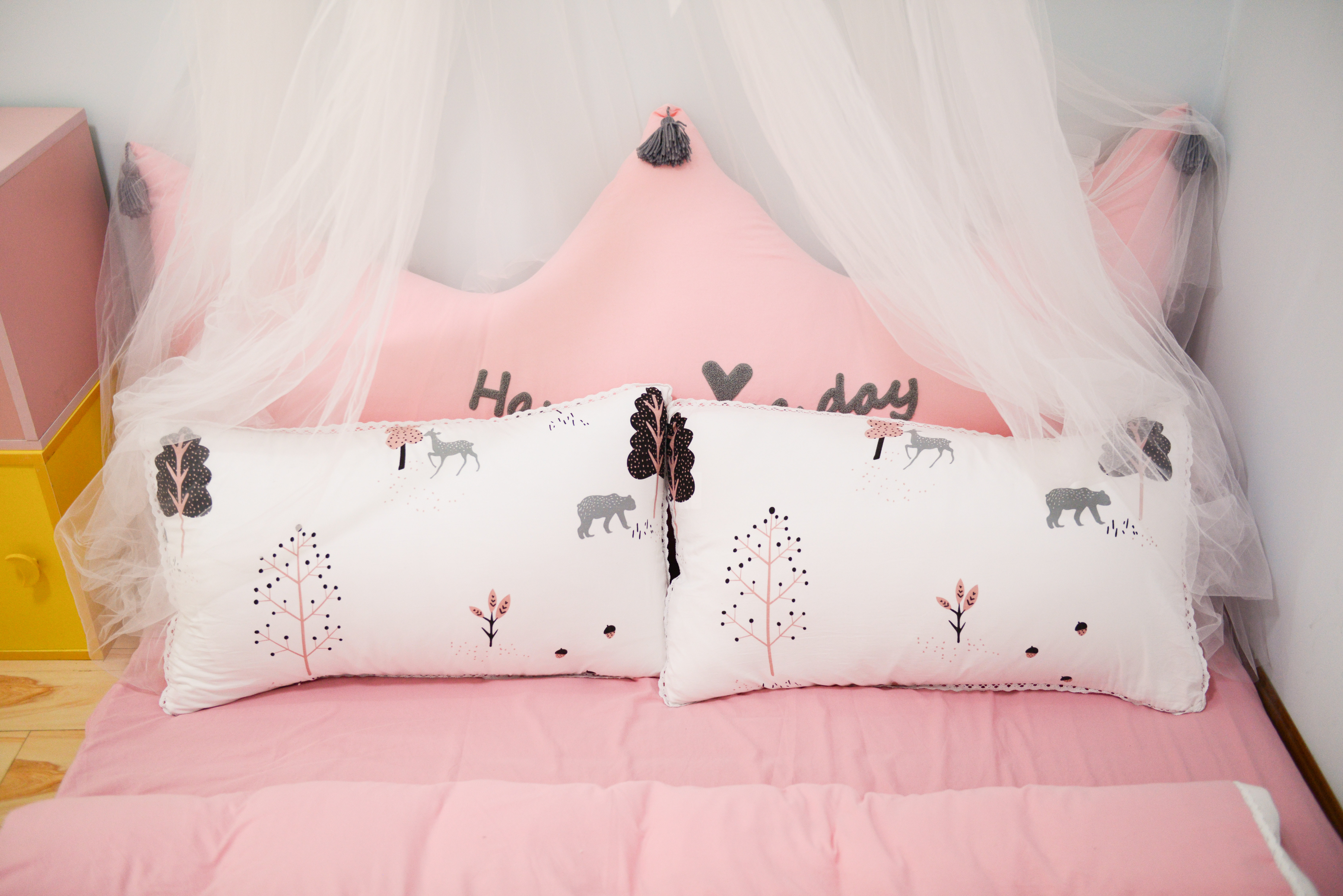 Pink bed sheets in a dorm room