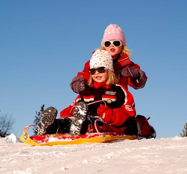 2 Girl's Playing on Snow