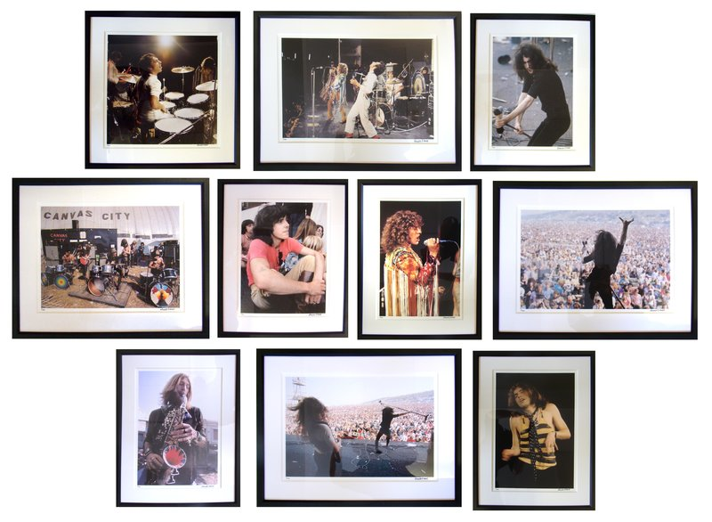 A series of photographs of rockstars hanging on a white wall