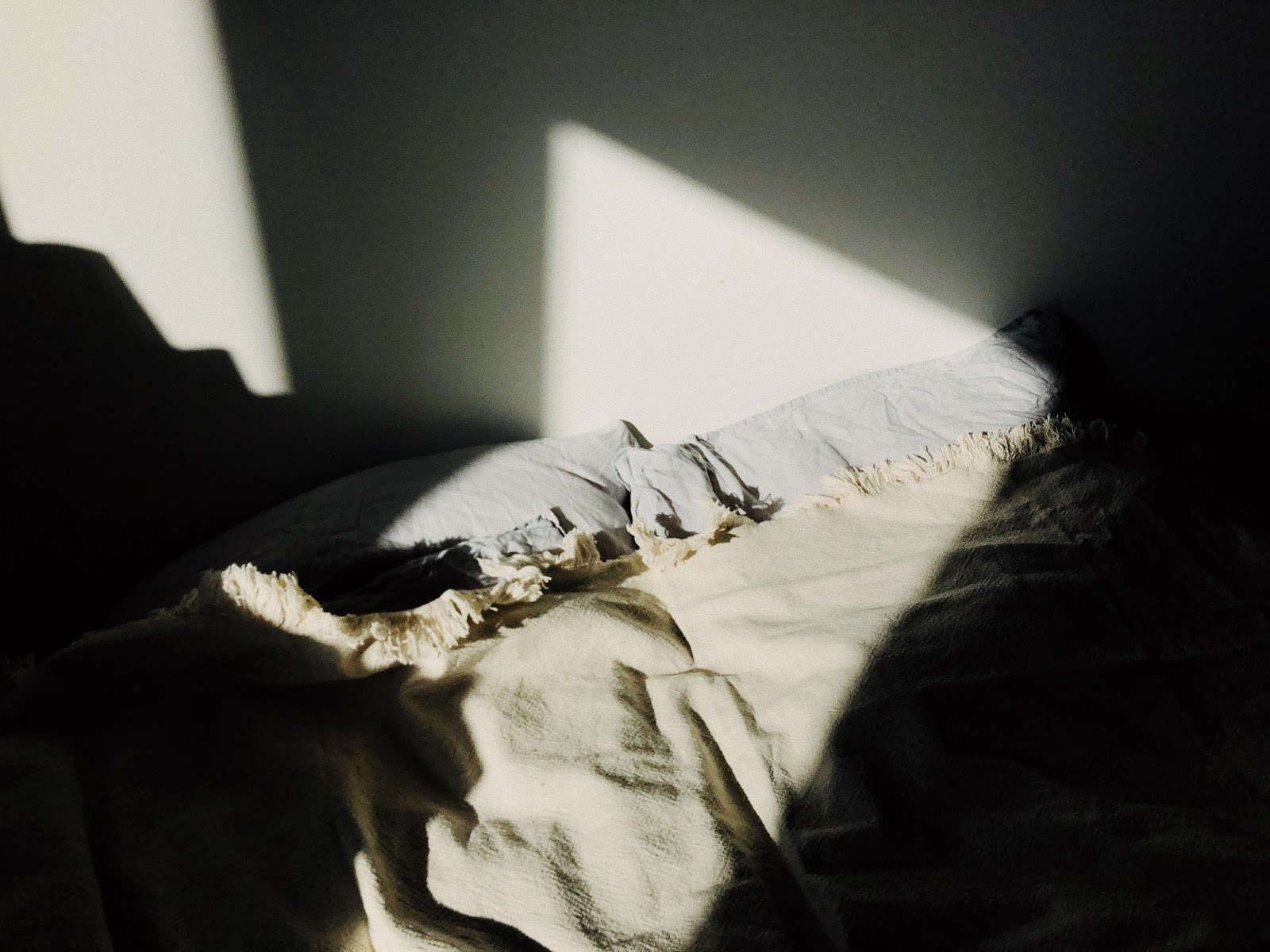 Blankets covered in shadows