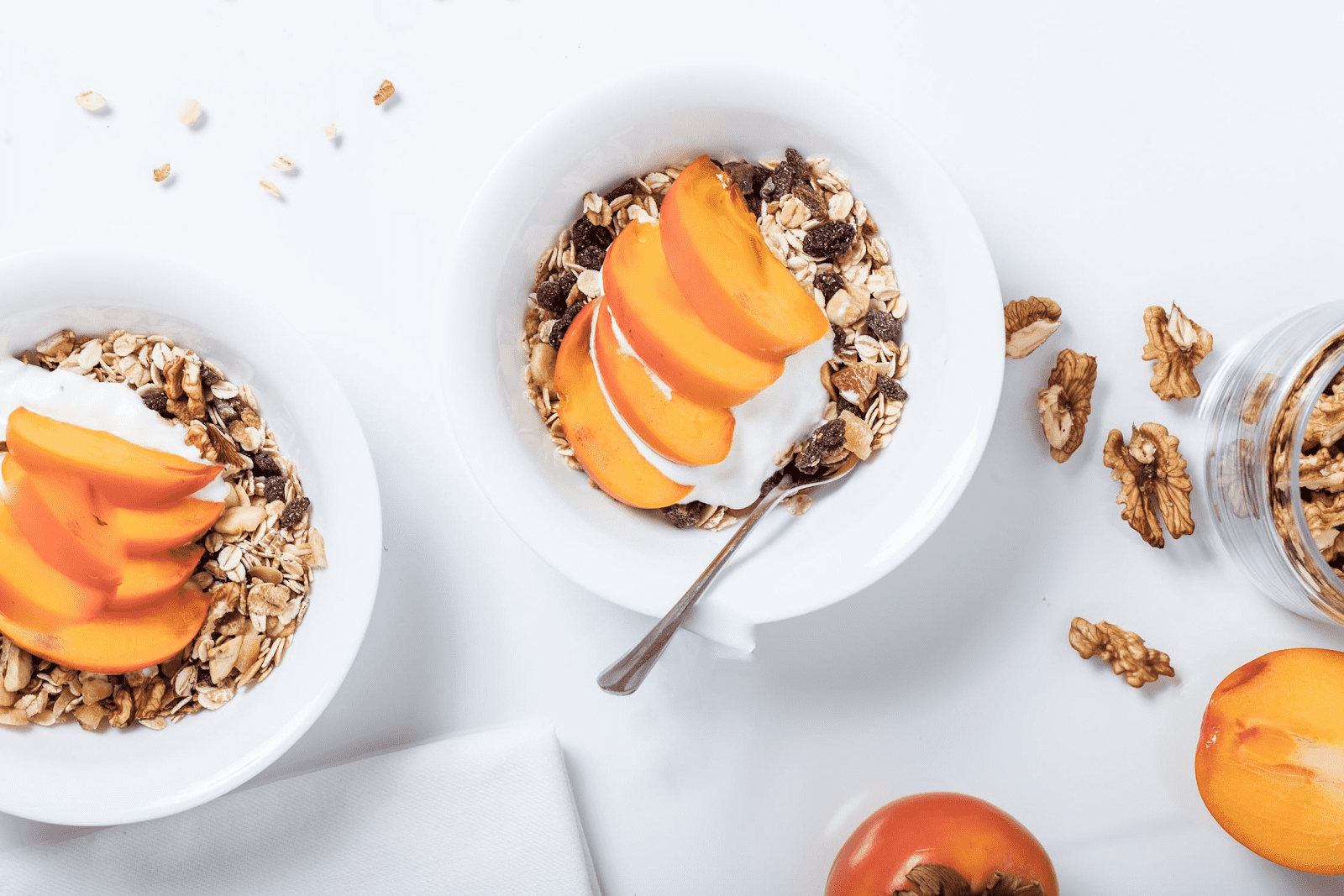 bowls of Oatmeal and muesli with peaches