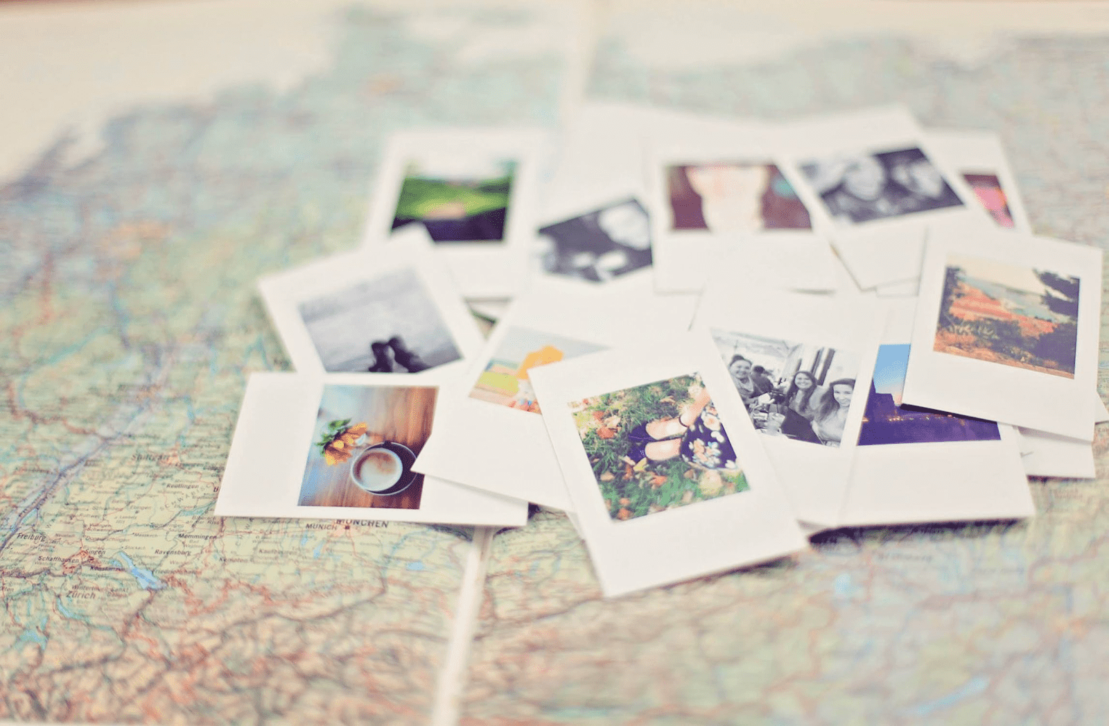 pile of photographs on a map
