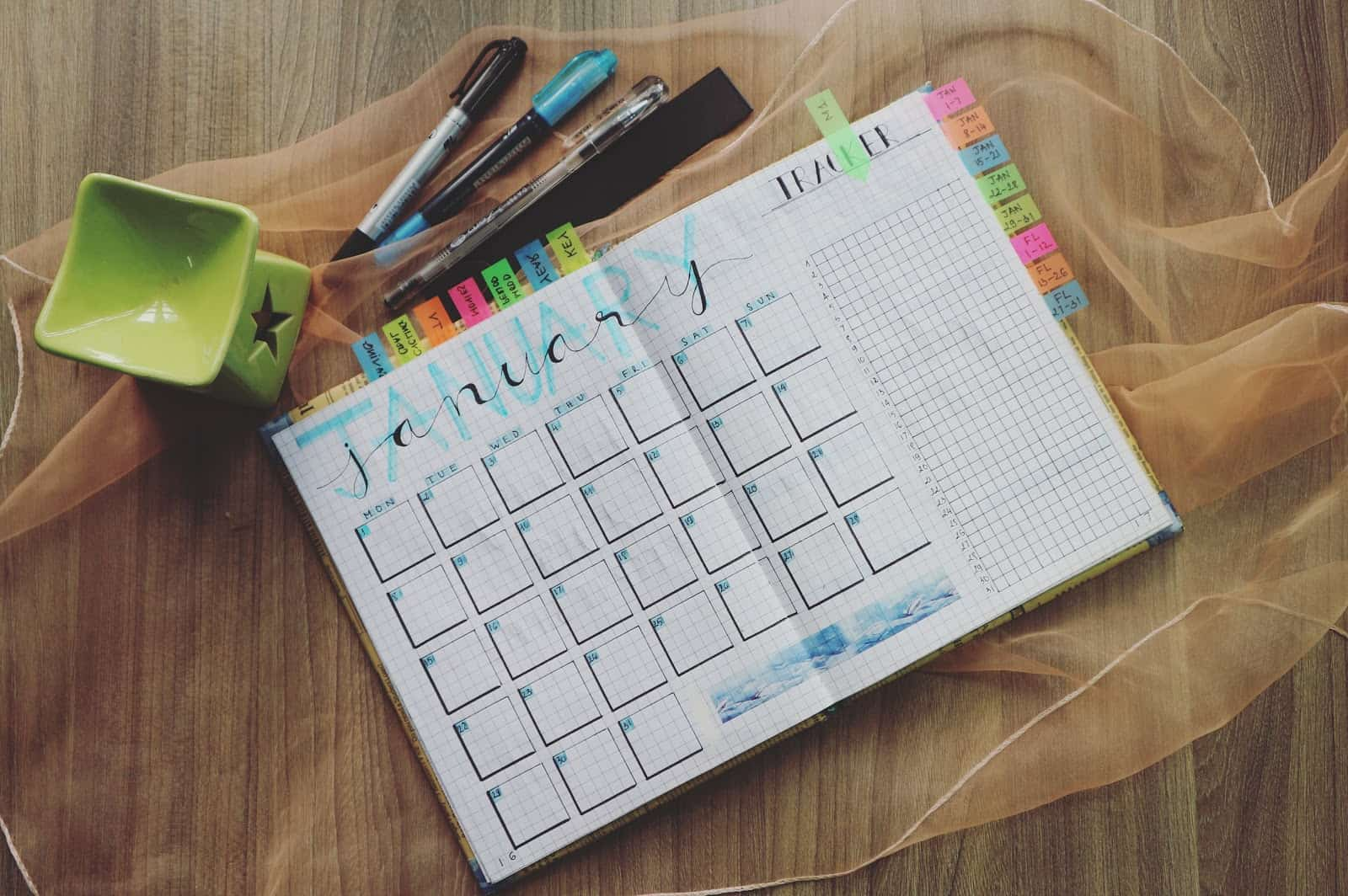 calendar with pens placed around the top