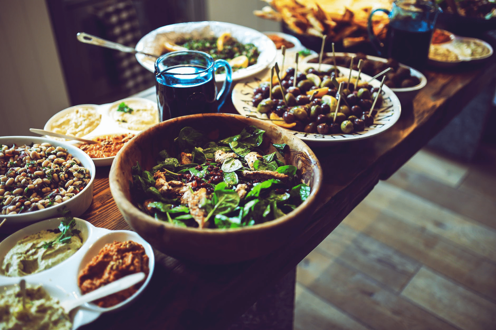 multiple plates of food on a serving tray