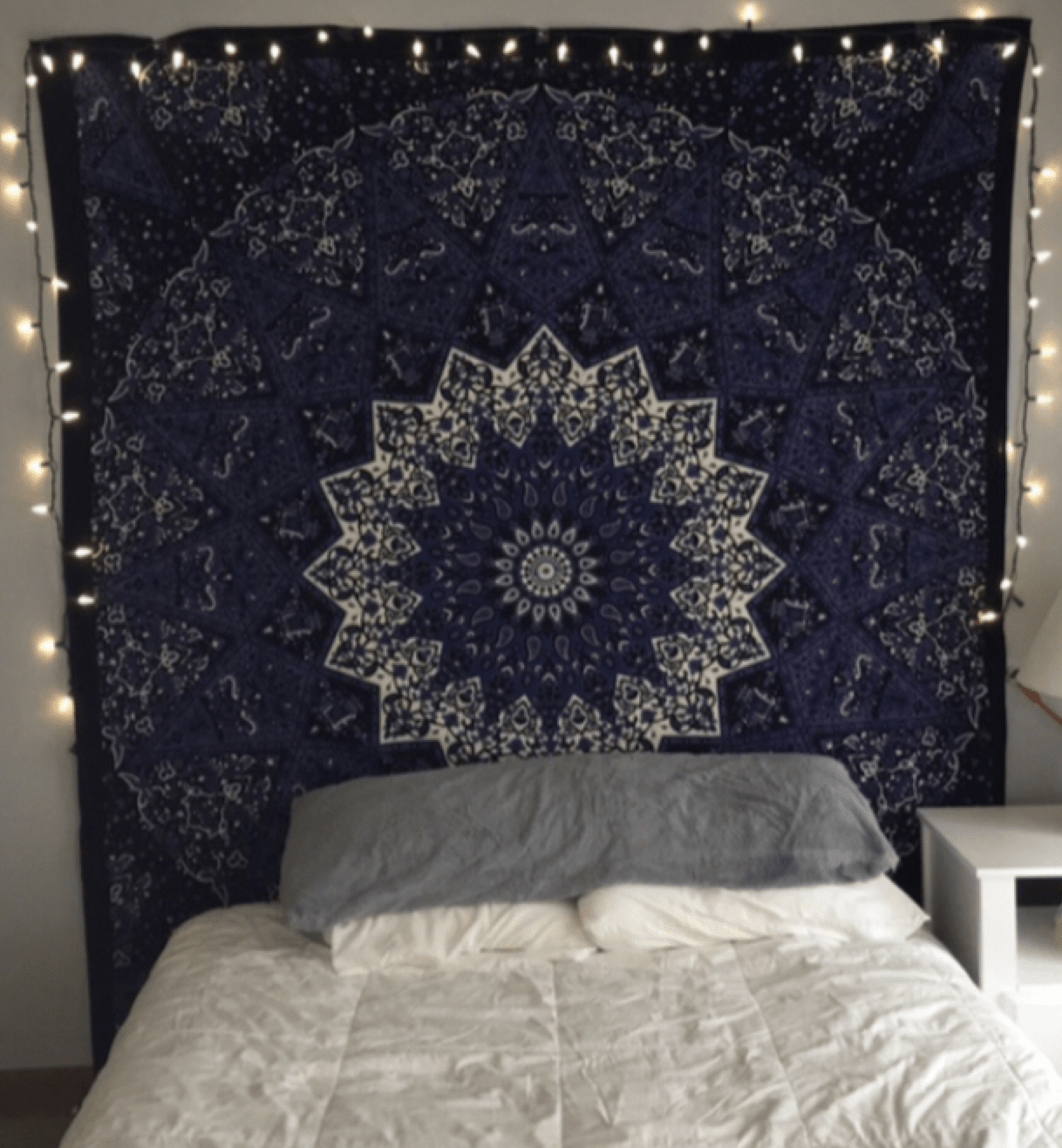 hanging tapestry over a bed