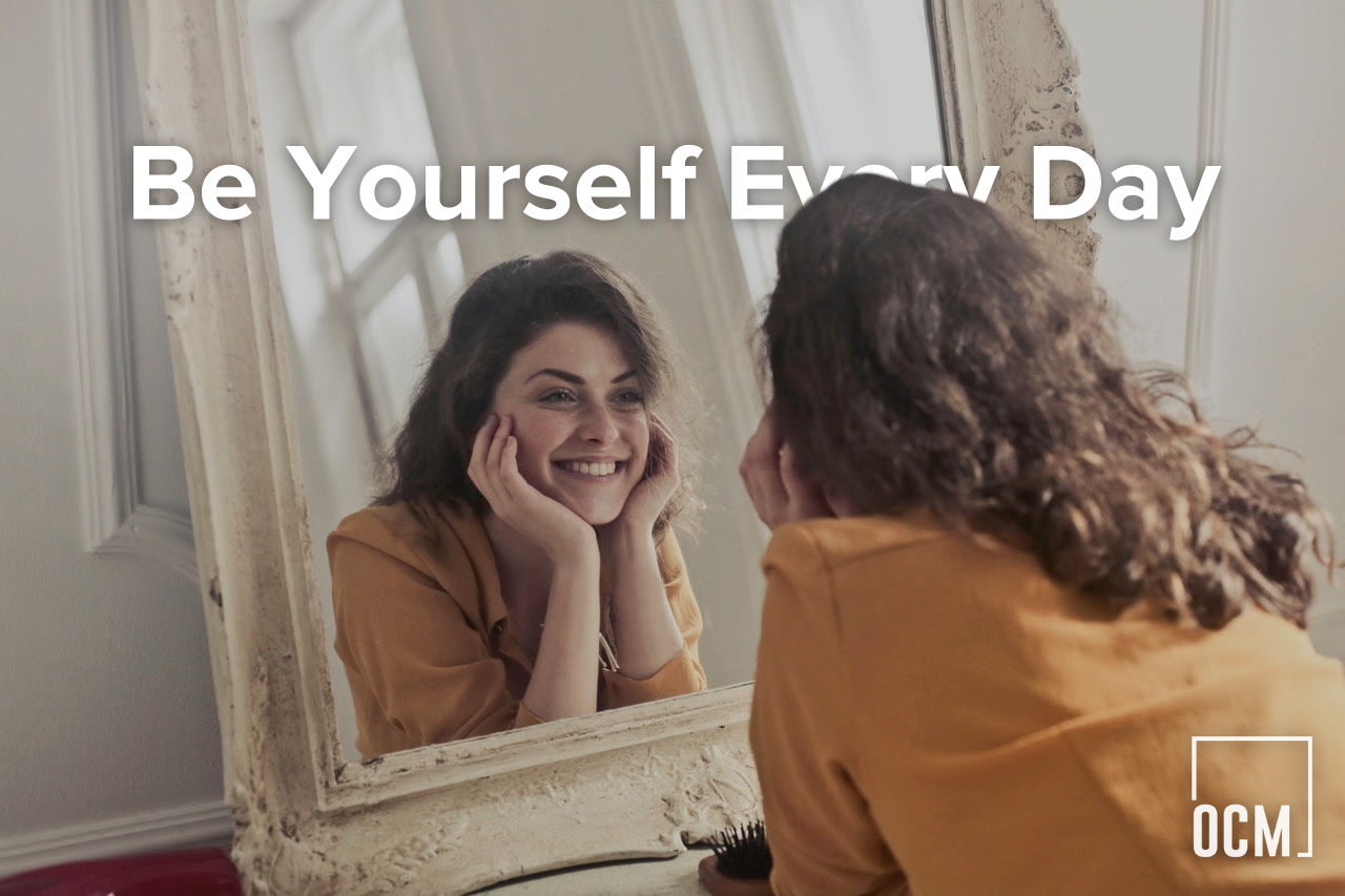 woman smilling in the mirror