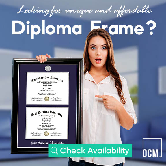 Woman hanging diploma frame