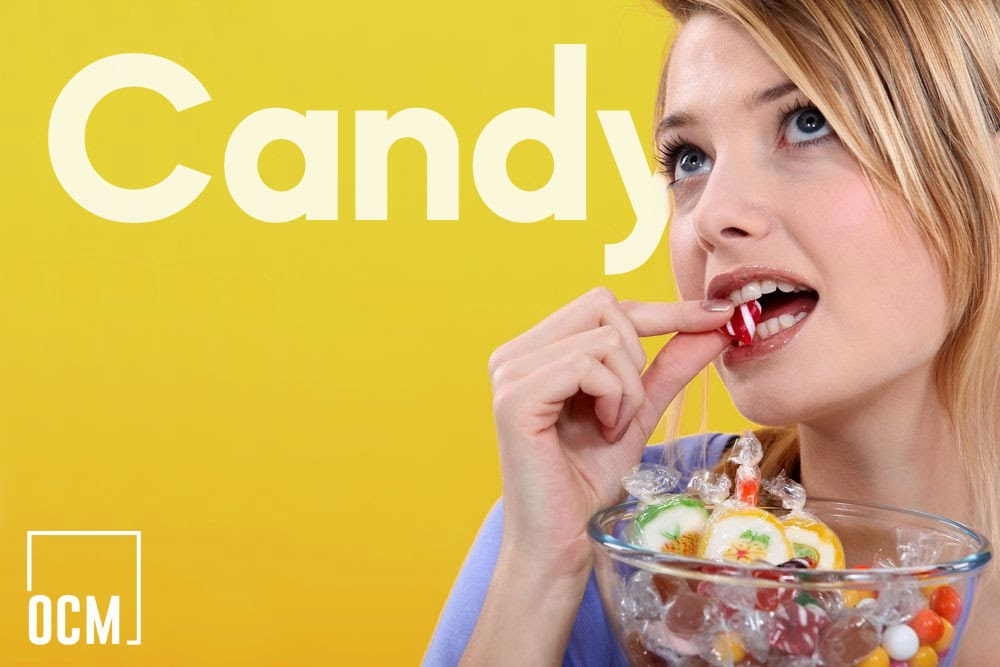Young woman eating candy