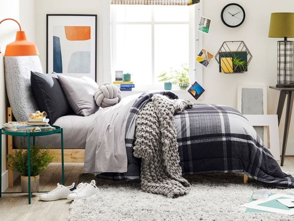 bedroom with black, gray and white themed bedding