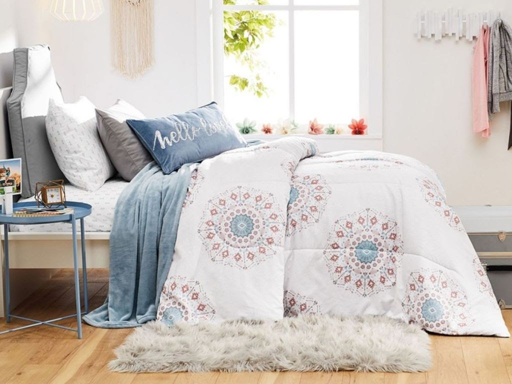 bedroom set with white, coral and blue themed bedding