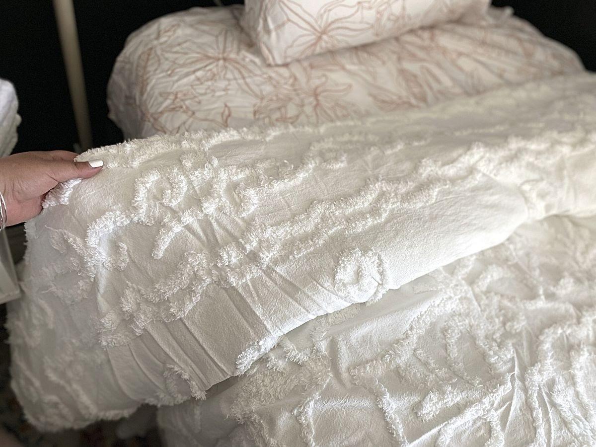 woman feeling comforter material