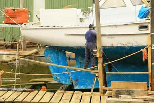 man fixing a boat