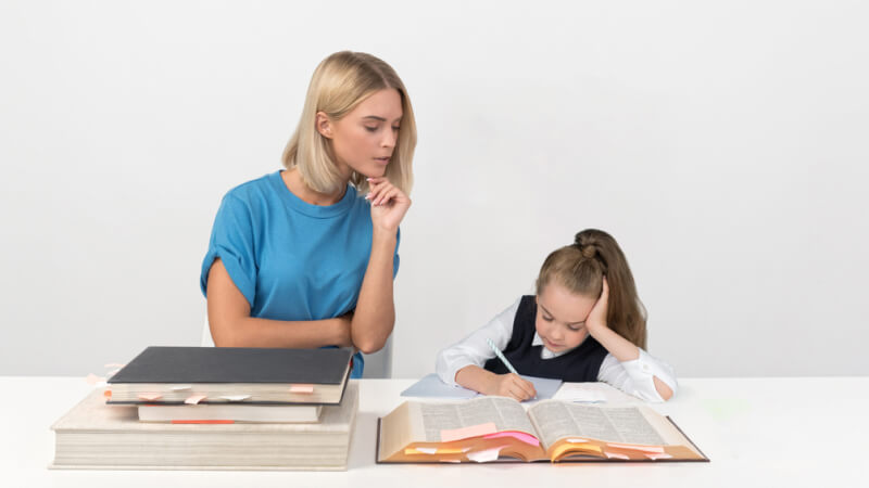 Parent and child working together on homework.