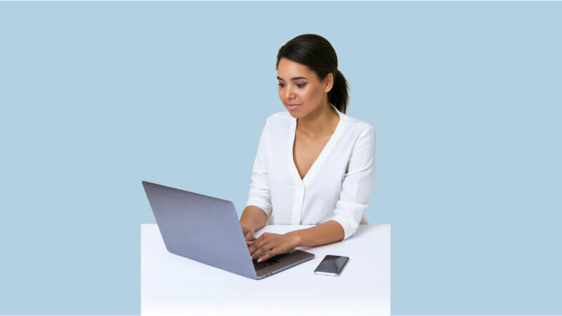 A young woman on her laptop at work