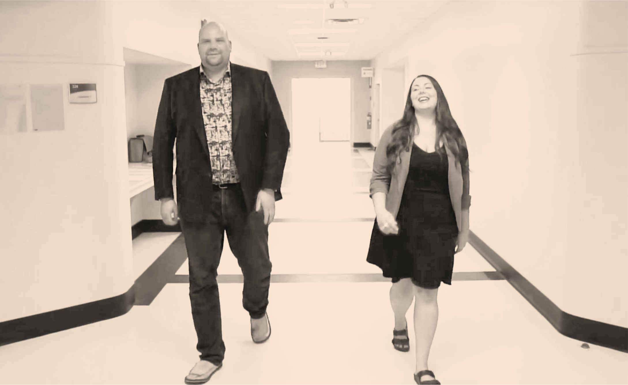 Keith Gelhorn and Alana Tattrie walking down the school hall