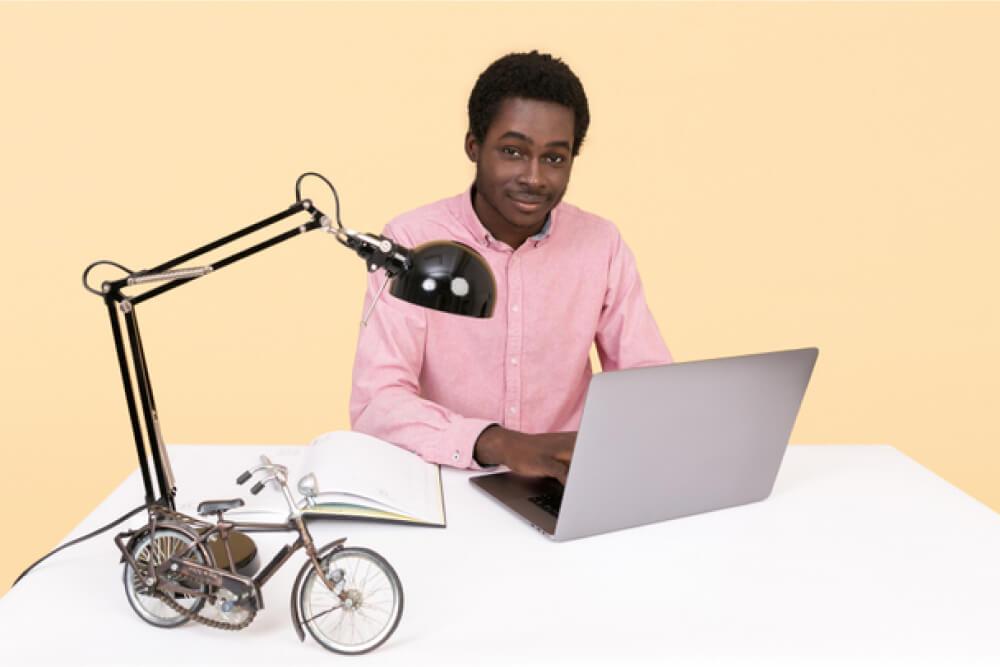 Young man enjoying studying.