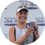 Rachel P. holding marathon trophy after being coached by Coach Bev