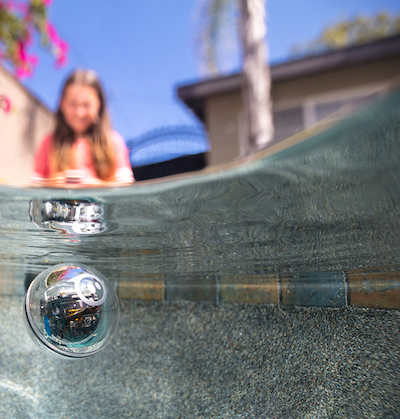 Sphero in the water with a child in the background